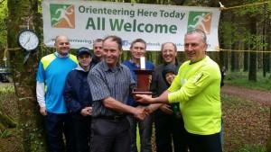 george receiving trophy
